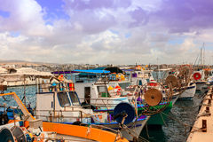 A row of fishing boats in a Cypriot harbor. Royalty Free Stock Image