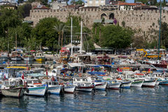 A row of fishing boats docked in Kaleici Harbour in the old town section of Antalya, Turkey. Royalty Free Stock Photo