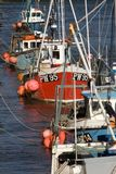 Fishing boats. A row of fishing boats moored in the harbour at Padstow, Cornwall, UK stock photography