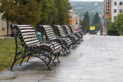 A row from five benches on the street Stock Photos