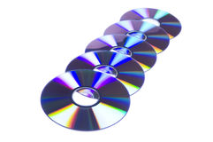 Row Of Five DVD Disks Royalty Free Stock Photos