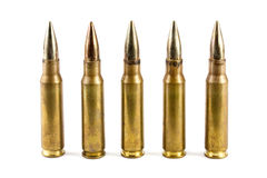 Row of five rifle bullets Stock Photo