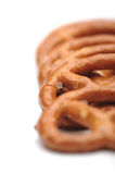 Row of five small salted pretzels Royalty Free Stock Images