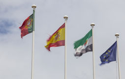Row of Flags waved by wind over white cloudy sky. Slow shot motion. Portugal, Spain, Extremadura, European Union Stock Photography