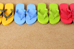 Flip flops summer beach sand background copy space Royalty Free Stock Image