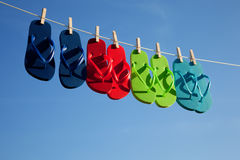 Row of flipflops against a blue sky Royalty Free Stock Photography