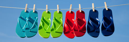 Row of flipflops against a blue sky Stock Photography