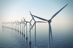 Row of floating wind turbines during hazy day. Stock Photo