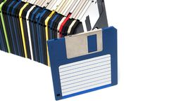 Row of floppy disks. Horizontal row of computer floppy disks isolated on a white background Royalty Free Stock Images