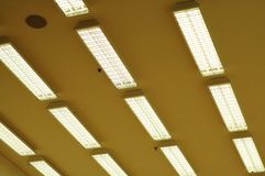 Row of fluorescent lamps. Rows of fluorescent lamps of office ceiling Stock Photo