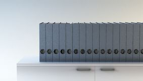 Row of folders. On bookshelf Stock Image
