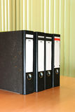 The row of the folders. The row of the black folders stock photos