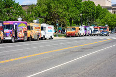 Row of food trucks - National mall, Washington DC. A row of food trucks on a road in national mall - May 2, 2015, Washington DC, USA Stock Images