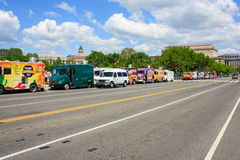 Row of food trucks - National mall, Washington DC. A row of food trucks on a road in national mall - May 2, 2015, Washington DC, USA Stock Photo