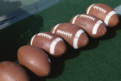 Row of footballs Stock Photos