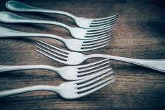 Row of Forks on a wooden board Stock Photos