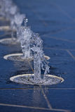 Row of fountains. A row of fountains spraying out water royalty free stock images