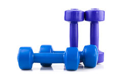Row of four  color dumbbell Royalty Free Stock Images