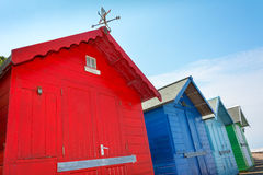 Row of four colourful beach huts. Royalty Free Stock Photo