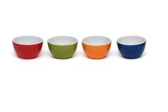 Row of four porcelain bowls isolated Stock Photography