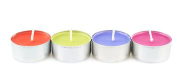 Row of four tea light candles Stock Photography