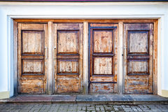 Row of four wooden doors Royalty Free Stock Photography