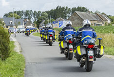 Row of French Policemen on Bikes - Tour de France 2016. Ardevon, France - July 2, 2016: Row of bikes of French Gendarmerie driving to the start of the Tour de Stock Photography
