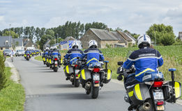 Row of French Policemen on Bikes - Tour de France 2016. Ardevon, France - July 2, 2016: Row of bikes of French Gendarmerie driving to the start of the Tour de Royalty Free Stock Photography