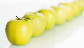 Row of fresh apples on white background. Royalty Free Stock Photography