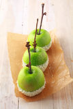 Row of fresh green apples dipped in sprinkles royalty free stock image