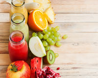Row Fresh Juices Smoothie Three Bottles Color Fruits Royalty Free Stock Images