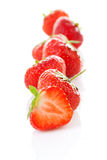 Row of fresh strawberries in closeup Stock Photos
