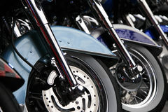 Row of front motorcycle wheels. Front motorcycle wheels lined up in a row Stock Images