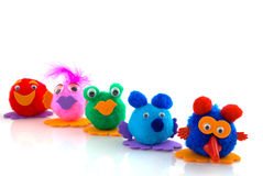 A row of funny dolls Stock Images