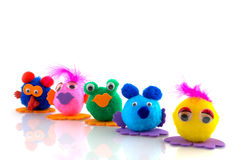 A row with funny dolls Stock Photo