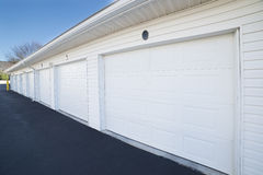 Row of garage doors at parking area for apartment homes Stock Photography