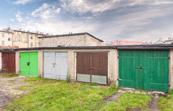 Row of garage doors in slum area Royalty Free Stock Photography