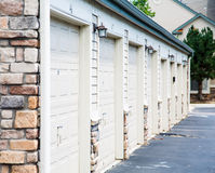 Row of Garage Doors. A row of garage doors in a stone building Royalty Free Stock Image