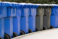 Row of garbage cans. Row of plastic garbage cans Stock Images