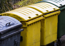 Row of garbage cans for waste separation. Row of garbage cans for wate separation and recycling Stock Photo