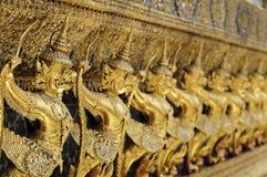 A row of Garuda's. The temple guards of the grand palace in Bangkok Royalty Free Stock Photos
