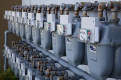 Row of gas meters. Two Rows of gray gas meters at an apartment complex Royalty Free Stock Photography