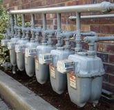 Row of gas meters with full manifolding royalty free stock image