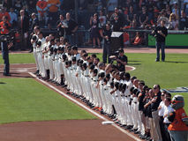 Row of Giants Players stand with hats removed during National an Stock Images