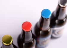 Row of glass bottles of drink royalty free stock photography