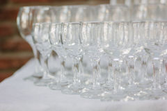 Row of glass on catering event on table. stock photo