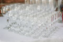 Row of glass on catering event on table. Row of glass on catering event on table stock photography