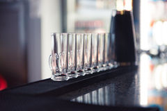 Row of glass shots at bar Royalty Free Stock Photography