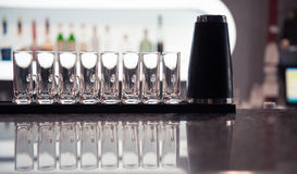 Row of glass shots at bar Royalty Free Stock Images