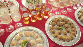 Row of glasses of alcohol and juice, a wide variety of snacks at the banquet. Row of glasses of alcohol and juice, wide variety of snacks at the banquet stock video